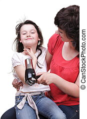 woman and daughter Little girl dries hair isolated - woman...