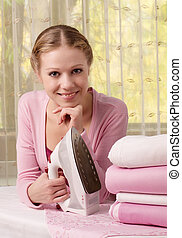 Happy woman ironing clothes - Happy young beautiful woman...