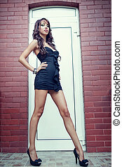 Young woman with long sexy legs