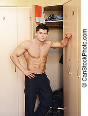 muscular male - muscular perfect male in locker room