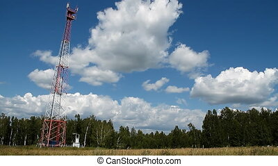 Communications tower 005 - High transmitter tower against...