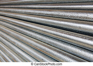 Diminishing Galvanized Pipe - Pile of shiny galvanized steel...