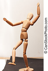 Wood manequin dancing - Wooden manequin figure dancing on...