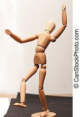 Wood manequin dancing - Wooden manequin figure dancing on...