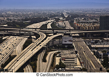 landing at Los Angeles Airport with view to streets and huge...