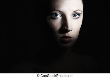 Mysterious portrait of a beautiful young woman