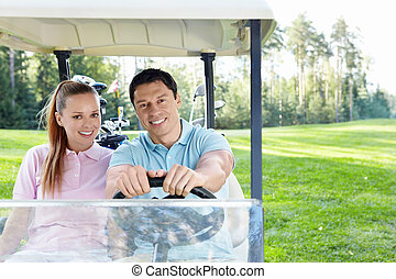 Smiling girl - Couple in a golf car