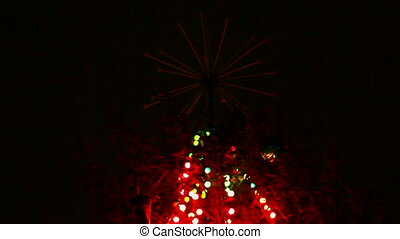 top of christmas fir with colored lightings