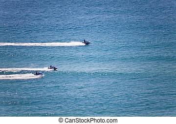 Jetskies - Three jetskies racing on the ocean