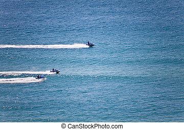 Jetskies - Three jetskies racing on the ocean
