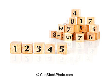 A lot of wooden blocks with numbers over white background
