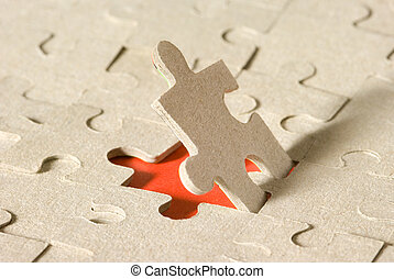 The person - Paper puzzles on a red background. One puzzle...