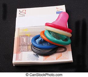 multicolored condoms - A stack of multicolored condoms a wad...