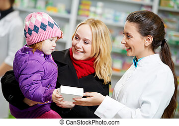 Pharmacy chemist, mother and child in drugstore - Cheerful...