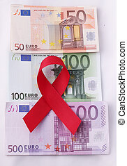 red ribbon - A red ribbon on wads of 50, 100, 500 Euro...