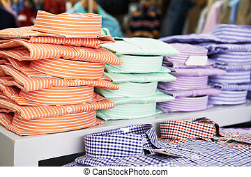 shirts in a shop - shoping sale background theme. shirts in...