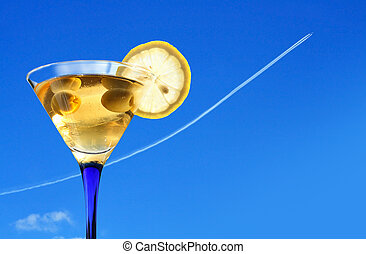 Happy Jorney! - Vacation concept. Martini glass against blue...