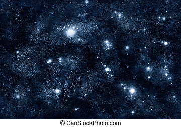 Image of stars and nebula clouds in deep space - abstract background of starfield universe