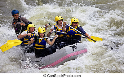 Group of people whitewater rafting - Group of five people...