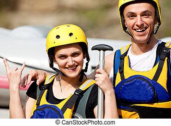 Happy couple with helmets
