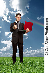 Full length portrait of male with laptop outdoors - Full...