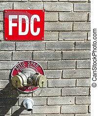 FIRE HYDRANT ON WALL - A connection for a sprinkler system...