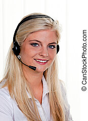 woman with telephone headset in a call center - young woman...