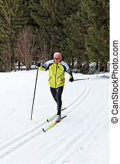 senior cross country skiing during the winter - senior in...
