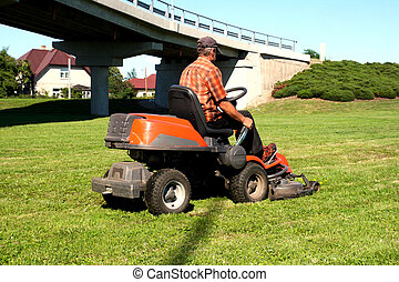 Man on a Lawn Tractor - Man on a riding lawn mower