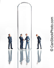 Business figurines and test tubes - Business figurines...