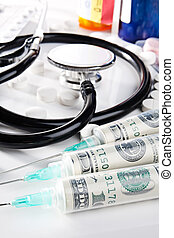 Cost of healthcare still life - Stethoscope, pills, and...