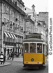 Yellow tram in Lisbon. - Classic tram on the streets of...