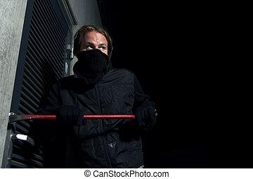 Burglar - man forcing a door