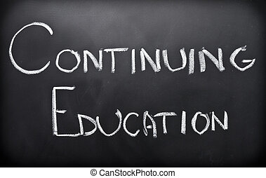 Continuing education written on classroom blackboard