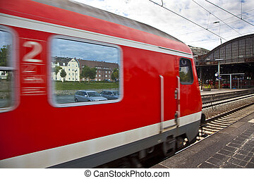 red train leaves the station - red train leaves the...