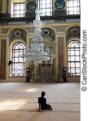 Child in Istanbul mosque - Interior details of a mosque in...