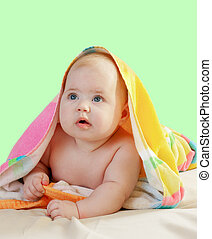 Adorable baby in colorful towel