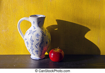 still-life with white jug and red apple and yellow...