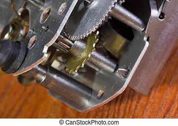 Gear Mechanism - Silver gear mechanism on an orange...