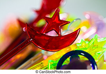 Red star - close up view of the colorful plastic stirrer...