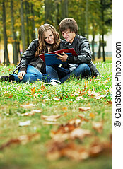 Two smiling young students outdoors - Two students studying...