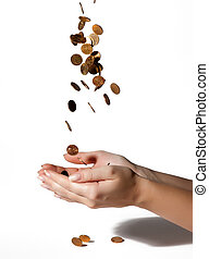 coins fall into his hands on white background