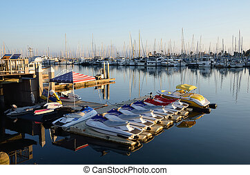 Jet skis in marina - Jet skis and boats in a marina just...