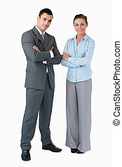 Business partner with arms folded against a white background...