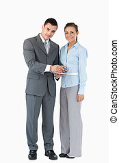Business partner with clipboard against a white background -...