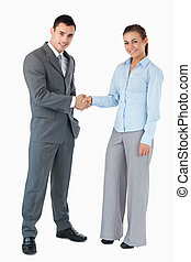 Business partner greeting each other against a white background
