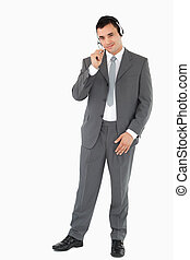 Businessman with headset on against a white background