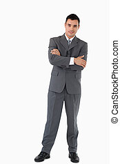 Businessman with arms folded against a white background