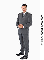 Businessman with hands folded against a white background