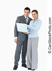 Business partner with laptop against a white background